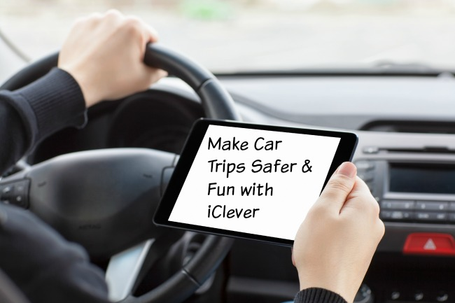 man sitting in the car and holding a touch tablet with isolated screen