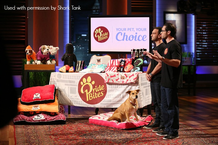 """SHARK TANK - """"Episode 728"""" - Two former advertising guys in New York try to sell the Sharks a cure for cell-phone addiction; emotions rise when entrepreneurs from Orlando, Florida talk about the inspiration behind their wireless cuddly toy that tells science and math stories to children; two pet lovers from Austin, Texas design and customize accessories for the most important member of the family: your one-of-a-kind pet; and two men from Huntington Beach, California hope they can lock up an investment deal with their high-tech """"smart"""" tool box. Also, Lori Greiner takes 10 of her entrepreneurs - whose combined sales now total $188 million -- to the Orgill Trade Show in Orlando, Florida, on """"Shark Tank,"""" FRIDAY, APRIL 8 (9:00-10:00 p.m. EDT) on the ABC Television Network. (ABC/Beth Dubber) SEAN KNECHT, STEVEN BLUSTEIN (PRIDEBITES PET PRODUCTS)"""