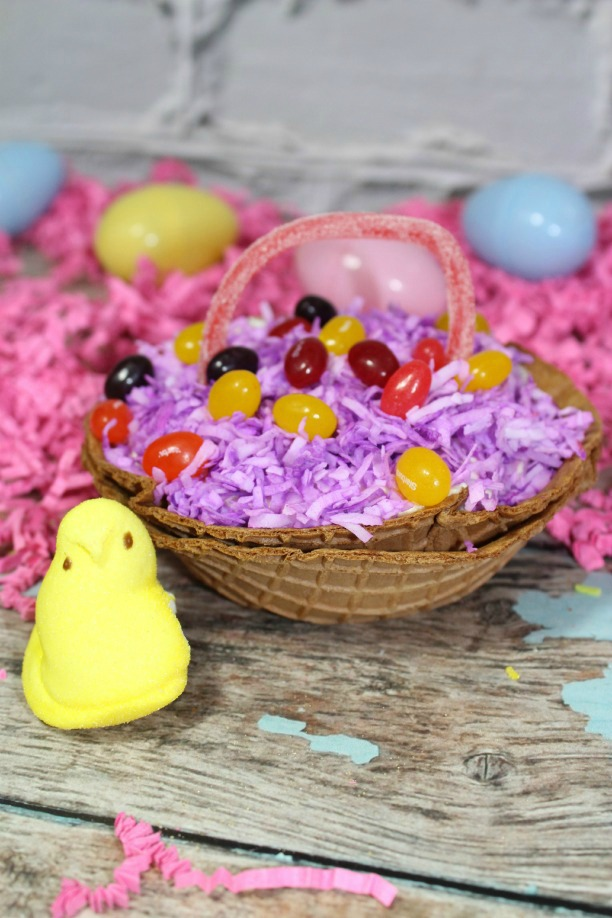 picture of yellow marshmallow peep and waffle cone basket with candy inside