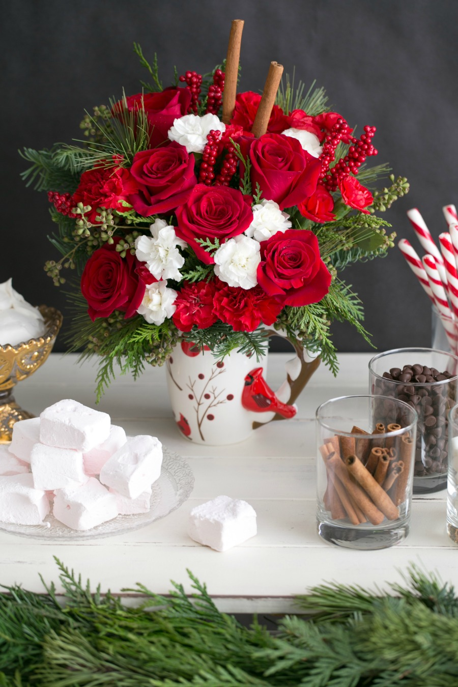 Looking for the perfect gift for someone this holiday season? See why we love the Send a Hug Christmas Cardinal Bouquet from Teleflora here!