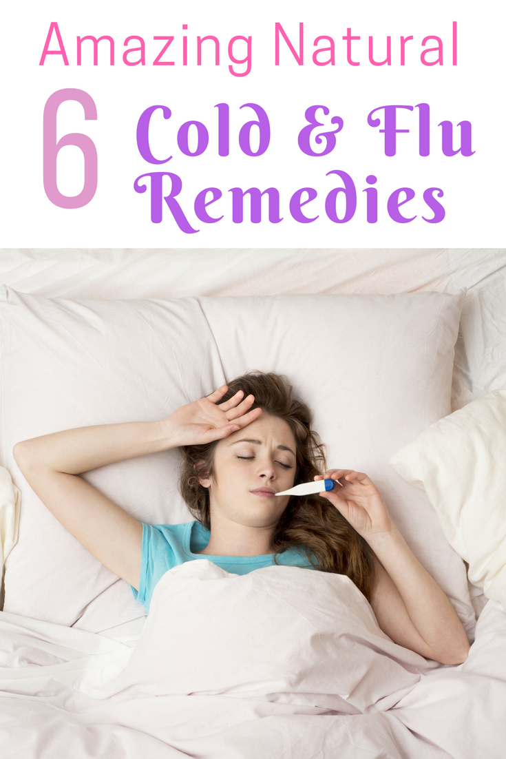 Picture of young brown haired sick woman taking temperature in bed with words 6 Amazing Natural Cold & Flu Remedies