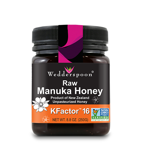 jar of Wedderspooon Raw Monuka Honey in a black and orange bottle