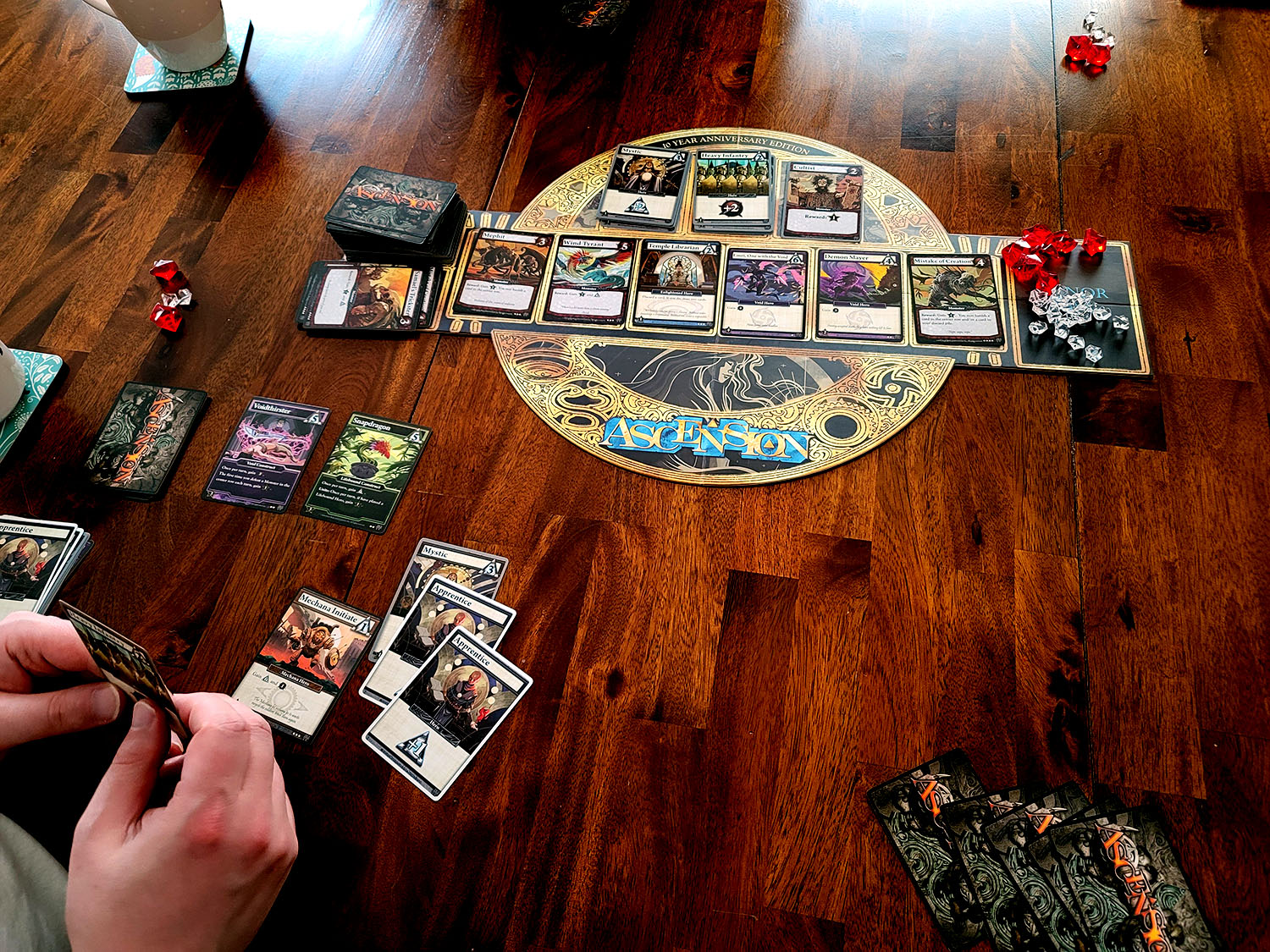 people around table playing Ascension the Board Game
